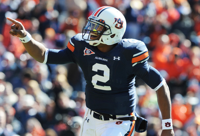 AUBURN, AL - NOVEMBER 6:  Quarterback Cam Newton #2 of the Auburn Tigers celebrates a touchdown run against the Chattanooga Mocs November 6, 2010 at Jordan-Hare Stadium in Auburn, Alabama.  (Photo by Al Messerschmidt/Getty Images)