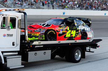 FORT WORTH, TX - NOVEMBER 07:  The #24 DuPont Chevrolet, driven by Jeff Gordon, gets towed down pit road after an incident in the NASCAR Sprint Cup Series AAA Texas 500 at Texas Motor Speedway on November 7, 2010 in Fort Worth, Texas.  (Photo by Robert La