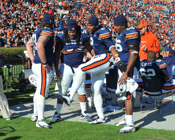 AUBURN, AL - NOVEMBER 6:  Quarterback Cam Newton #2 of the Auburn Tigers shows his teammates how he scored against the Chattanooga Mocs November 6, 2010 at Jordan-Hare Stadium in Auburn, Alabama.  (Photo by Al Messerschmidt/Getty Images)