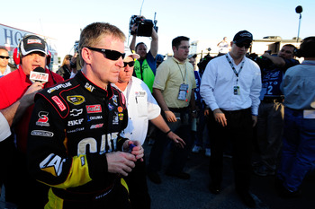 FORT WORTH, TX - NOVEMBER 07:  Jeff Burton, driver of the #31 Caterpillar Chevrolett, talks to the media as he walks from the infield care center after an incident with Jeff Gordon in the NASCAR Sprint Cup Series AAA Texas 500 at Texas Motor Speedway on N