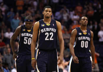 PHOENIX - NOVEMBER 05:  (L-R) Zach Randolph #50, Rudy Gay #22 and Darrell Arthur #00 of the Memphis Grizzlies react in the final moments of the NBA game against the Phoenix Suns at US Airways Center on November 5, 2010 in Phoenix, Arizona. The Suns defeat
