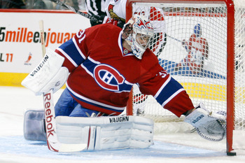 MONTREAL- NOVEMBER 6:  Carey Price #31 of the Montreal Canadiens reaches to stop the puck that hit the post during the NHL game against the Ottawa Senators at the Bell Centre on November 6, 2010 in Montreal, Quebec, Canada.  (Photo by Richard Wolowicz/Get