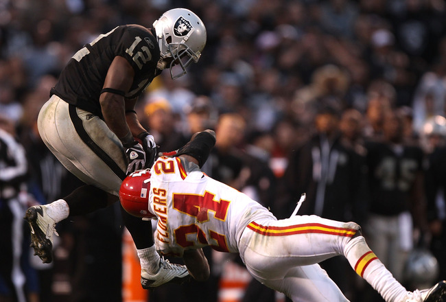 OAKLAND, CA - NOVEMBER 07:  Jacoby Ford #12 of the Oakland Raiders catches a pass over Brandon Flowers #24 of the Kansas City Chiefs during an NFL game at Oakland-Alameda County Coliseum on November 7, 2010 in Oakland, California.  (Photo by Jed Jacobsohn