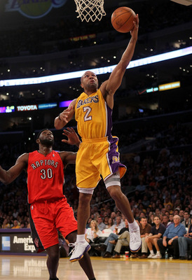 LOS ANGELES, CA - NOVEMBER 05: Derek Fisher #2  of the Los Angeles Lakers shoots over Reggie Evans #30 of the Toronto Raptors at Staples Center on November 5, 2010 in Los Angeles, California.   NOTE TO USER: User expressly acknowledges and agrees that, by