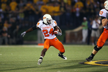 COLUMBIA, MO - OCTOBER 11:  Kendall Hunter #24 of the Oklahoma State Cowboys cuts back against the Missouri Tigers on October 11, 2008 at Memorial Stadium in Columbia, Missouri.  Oklahoma State won 28-23. (Photo by G. Newman Lowrance/Getty Images)