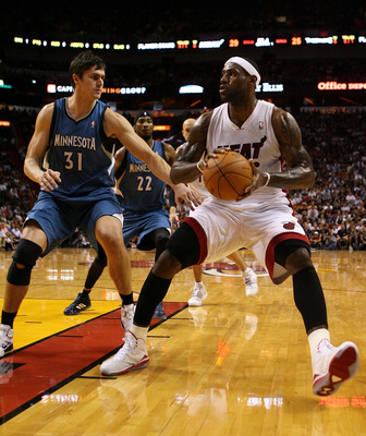 MIAMI - NOVEMBER 02:  Forward LeBron James #6 of the Miami Heat drives around center Darko Milicic #30 of the Minnesota Wolves at American Airlines Arena on November 2, 2010 in Miami, Florida. NOTE TO USER: User expressly acknowledges and agrees that, by