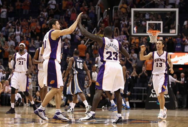 PHOENIX - NOVEMBER 05:  Hedo Turkoglu #19 of the Phoenix Suns high fives teammate Jason Richardson #23 after Richardson hit a basket late in the NBA game against the Memphis Grizzlies at US Airways Center on November 5, 2010 in Phoenix, Arizona. The Suns