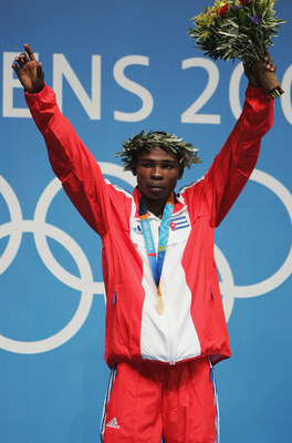 ATHENS - AUGUST 29:  Guillermo Rigondeaux Ortiz of Cuba receives his Gold medal for the men's boxing 54 kg event on August 29, 2004 during the Athens 2004 Summer Olympic Games at Peristeri Olympic Boxing Hall in Athens, Greece. (Photo by Al Bello/Getty Im