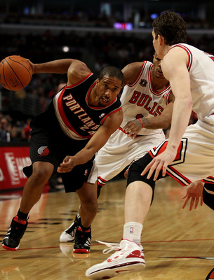 CHICAGO - NOVEMBER 01: Andre Miller #24 of the Portland Trail Blazers drives against Derrick Rose #1 and Omer Asik #3 of the Chicago Bulls at the United Center on November 1, 2010 in Chicago, Illinois. NOTE TO USER: User expressly acknowledges and agrees
