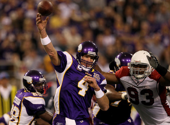 MINNEAPOLIS - NOVEMBER 07:  Quarterback Brett Favre #4 of the Minnesota Vikings throws a pass as defensive end Calais Campbell #93 of the Arizona Cardinals closes in at Hubert H. Humphrey Metrodome on November 7, 2010 in Minneapolis, Minnesota.  (Photo by