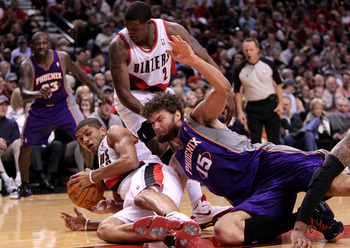 PORTLAND, OR - OCTOBER 26:  Nicolas Batum #88 of the Portland Trail Blazers battles Robin Lopez #15 of the Phoeinx Suns on October 26, 2010 at the Rose Garden in Portland, Oregon.  NOTE TO USER: User expressly acknowledges and agrees that, by downloading