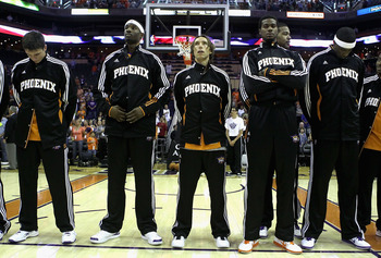 PHOENIX - OCTOBER 12:  Steve Nash #13 of the Phoenix Suns stands with teammates for the National Anthem before the preseason NBA game against the Utah Jazz at US Airways Center on October 12, 2010 in Phoenix, Arizona. NOTE TO USER: User expressly acknowle