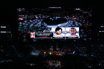 ARLINGTON, TX - MARCH 13:  The video screen previews the fight between Manny Pacquiao of the Philippines and Joshua Clottey of Ghana before their WBO welterweight title fight at Cowboys Stadium on March 13, 2010 in Arlington, Texas.  (Photo by Tom Penning