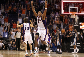 PHOENIX - NOVEMBER 05:  Channing Frye #8 of the Phoenix Suns celebrates after Jason Richardson (not pictured) tied the game in the final seconds to force overtime against the Memphis Grizzlies during the NBA game at US Airways Center on November 5, 2010 i