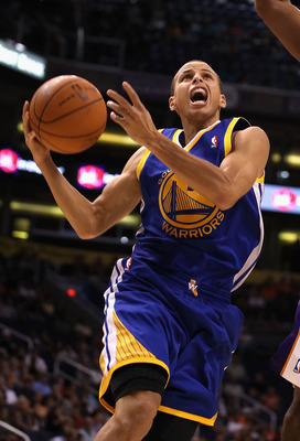 PHOENIX - OCTOBER 19:  Stephen Curry #30 of the Golden State Warriors drives to the basket during the preseason NBA game against the Phoenix Suns at US Airways Center on October 19, 2010 in Phoenix, Arizona. NOTE TO USER: User expressly acknowledges and a