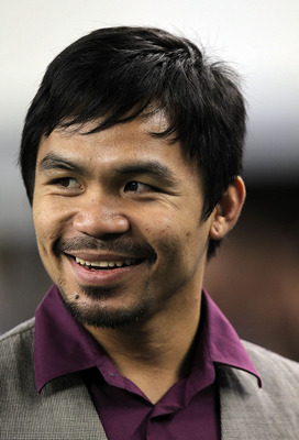 ARLINGTON, TX - SEPTEMBER 02:  Professional boxer Manny Pacquiao watches a preseason game between the Miami Dolphins and the Dallas Cowboys at Cowboys Stadium on September 2, 2010 in Arlington, Texas.  (Photo by Ronald Martinez/Getty Images)