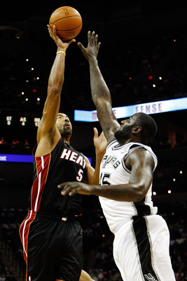 SAN ANTONIO - OCTOBER 09:  Juwan Howard #5 of the Miami Heat makes a shot over DeJuan Blair #45 of the San Antonio Spurs at the AT&T Center on October 9, 2010 in San Antonio, Texas.  NOTE TO USER: User expressly acknowledges and agrees that, by downloadin