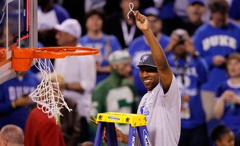 INDIANAPOLIS - APRIL 05:  Nolan Smith of the Duke Blue Devils celebrates after he cut down a piece of the net following their 61-59 win against the Butler Bulldogs during the 2010 NCAA Division I Men's Basketball National Championship game at Lucas Oil St