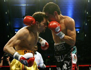 ATLANTIC CITY, NJ  - APRIL 12: Antonio Margarito (R) throws a punch during his IBF World Welterweight Title bout against Kermit Cintron at Boardwalk Hall on April 12, 2008 in Atlantic City, New Jersey. (Photo by Jeff Zelevansky/Getty Images)