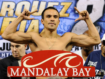 LAS VEGAS - JULY 30:  WBA/WBO lightweight champion Juan Manuel Marquez poses on the scale during the official weigh-in for his fight against Juan Diaz at the Mandalay Bay Events Center July 30, 2010 in Las Vegas, Nevada. Marquez will defend his titles aga
