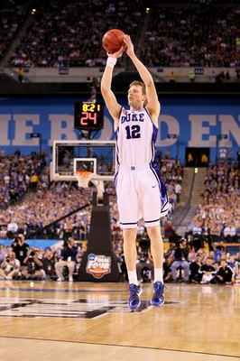 INDIANAPOLIS - APRIL 05: Kyle Singler #12 of the Duke Blue Devils attempts a shot against the Butler Bulldogs during the 2010 NCAA Division I Men's Basketball National Championship game at Lucas Oil Stadium on April 5, 2010 in Indianapolis, Indiana. Duke