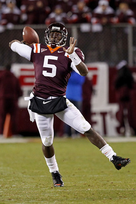 BLACKSBURG, VA - NOVEMBER 04:  Quarterback Tyrod Taylor #5 of the Virginia Tech Hokies throws the ball against the Georgia Tech Yellow Jackets at Lane Stadium on November 4, 2010 in Blacksburg, Virginia.  (Photo by Geoff Burke/Getty Images)