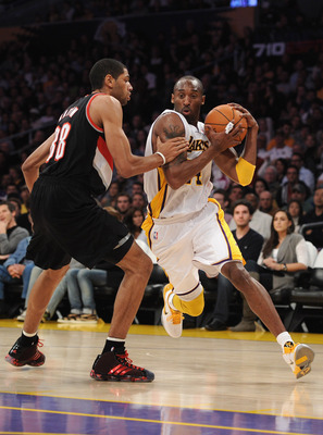 LOS ANGELES, CA - NOVEMBER 07:  Kobe Bryant #24 of the Los Angeles Lakers dribbles around Nicolas Batum of the Portland Trail Blazers at the Staples Center on November 7, 2010 in Los Angeles, California.  NOTE TO USER: User expressly acknowledges and agre