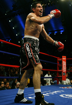 ATLANTIC CITY, NJ  - APRIL 12: Antonio Margarito celebrates his win over  Kermit Cintron in the sixth rounf of their IBF World Welterweight Title bout at Boardwalk Hall on April 12, 2008 in Atlantic City, New Jersey. (Photo by Jeff Zelevansky/Getty Images