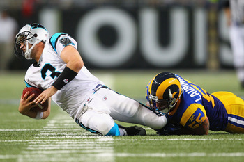 Carolina Panthers QB Matt Moore goes down at the hands of Rams LB James Laurinaitus
