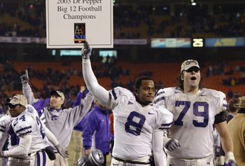 KANSAS CITY, MO - DECEMBER 6:  Defensive back James McGill #8 and tackle Jon Doty #79 of the Kansas State Wildcats celebrate after defeating the Oklahoma Sooners in the Dr. Pepper Big 12 Championship on December 6, 2003 at Arrowhead Stadium in Kansas City