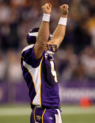 MINNEAPOLIS - NOVEMBER 07:  Quarterback Brett Favre #4 of the Minnesota Vikings celebrates after his 25 yard touchdown pass tied the game with the Arizona Cardinals in the fourth quarter at Hubert H. Humphrey Metrodome on November 7, 2010 in Minneapolis,