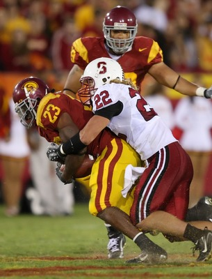 LOS ANGELES - OCTOBER 6:  Bo McNally #22 of the Stanford University Cardinal tackles Chauncey Washington #23 of the USC Trojans at the Los Angeles Memorial Coliseum October 6, 2007 in Los Angeles, California.  (Photo by Lisa Blumenfeld/Getty Images)