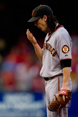 ST. LOUIS - AUGUST 21: Starter Tim Lincecum #55 of the San Francisco Giants reacts to giving up a home run against the St. Louis Cardinals at Busch Stadium on August 21, 2010 in St. Louis, Missouri.  (Photo by Dilip Vishwanat/Getty Images)