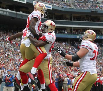 SEATTLE - SEPTEMBER 12:  Wide receiver Josh Morgan #84 of the San Francisco 49ers celebrates with Vernon Davis #85 and Joe Staley #74 after scoring an apparent touchdown during the NFL season opener against the Seattle Seahawks at Qwest Field on September