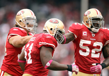 SAN FRANCISCO - OCTOBER 17:  Takeo Spikes #51 of the San Francisco 49ers is congratulated by teammates after he made an interception during their game against the Oakland Raiders at Candlestick Park on October 17, 2010 in San Francisco, California.  (Phot