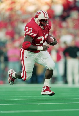 13 Nov 1999: Ron Dayne #33 of the Wisconsin Badgers carries the ball  during the game against the  Iowa Hawkeyes at the Camp Randall Stadium in Madison, Wisconsin. The Badgers defeated the Hawkeyes 41-3. Mandatory Credit: Matthew Stockman  /Allsport