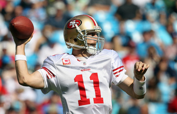 CHARLOTTE, NC - OCTOBER 24:  Alex Smith #11 of the San Francisco 49ers drops back to throw a pass against the Carolina Panthers during their game at Bank of America Stadium on October 24, 2010 in Charlotte, North Carolina.  (Photo by Streeter Lecka/Getty
