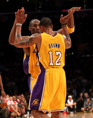 LOS ANGELES - NOVEMBER 5:  Kobe Bryant #24 and Shannon Brown #12 of the Los Angeles Lakers celebrate in the game with the Toronto Raptors at Staples Center on November 5, 2010 in Los Angeles, California.  The Lakers won 108-102.   NOTE TO USER: User expre