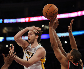 LOS ANGELES, CA - NOVEMBER 07:  Pau Gasol #16 of the Los Angeles Lakers passes over LaMarcus Aldridge #12 of the Portland Trail Blazers at the Staples Center on November 7, 2010 in Los Angeles, California.  NOTE TO USER: User expressly acknowledges and ag