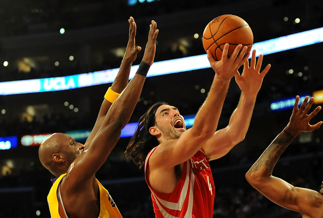 LOS ANGELES, CA - MAY 06:  Luis Scola #4 of the Houston Rockets goes up for a shot between Lamar Odom #7 and Trevor Ariza #3 of the Los Angeles Lakers in Game Two of the Western Conference Semifinals during the 2009 NBA Playoffs at Staples Center on May 6