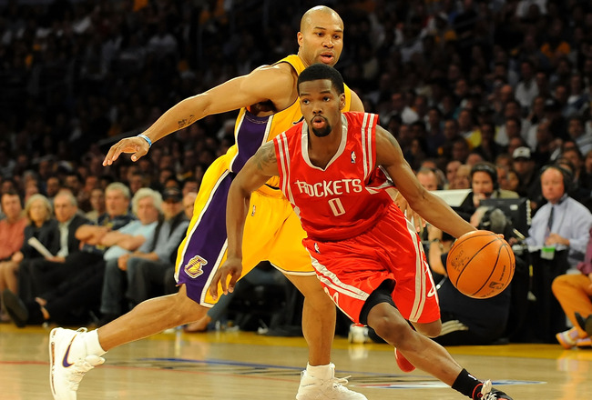 LOS ANGELES, CA - MAY 06:  Aaron Brooks #0 of the Houston Rockets moves the ball in front of Derek Fisher #2 of the Los Angeles Lakers in Game Two of the Western Conference Semifinals during the 2009 NBA Playoffs at Staples Center on May 6, 2009 in Los An