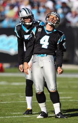 CHARLOTTE, NC - NOVEMBER 07:  Teammates Jason Baker #7 and John Kasay #4 of the Carolina Panthers react to a missed field goal against the New Orleans Saints during their game at Bank of America Stadium on November 7, 2010 in Charlotte, North Carolina.  (