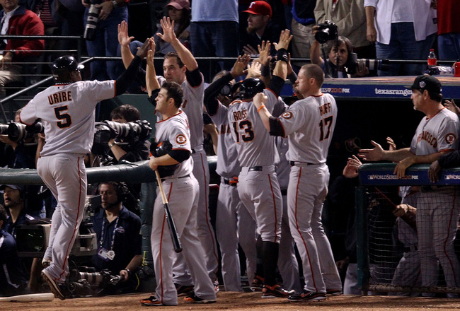 ARLINGTON, TX - NOVEMBER 01:  Edgar Renteria #16 of the San Francisco Giants celebrates with teammates after hitting a 3-run homer to centerfield against the Texas Rangers in the top of the seventh inning of Game Five of the 2010 MLB World Series at Range