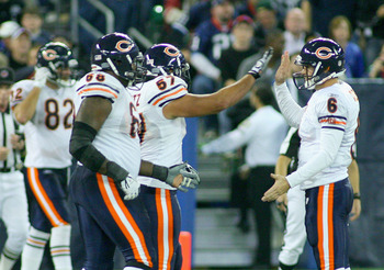 TORONTO, ON - NOVEMBER 07: Jay Cutler #6 and Olin Kreutz #57  of the Chicago Bears celebrate Earl Bennett's game winning touchdown against the Buffalo Bills  at Rogers Centre on November 7, 2010 in Toronto, Canada. Chicago won 22-19. (Photo by Rick Stewar