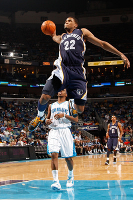 NEW ORLEANS - JANUARY 20:  Rudy Gay #22 of the Memphis Grizzlies goes up for a dunk over Chris Paul #3 of the New Orleans Hornets at the New Orleans Arena on January 20, 2010 in New Orleans, Louisiana.  The Hornets defeated the Grizzlies 113-111.  NOTE TO