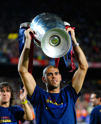 BARCELONA, SPAIN - MAY 28: Victor Valdes holds the UEFA Champions League trophy with Alksander Hleb at the Nou Camp stadium the day after Barcelona won the UEFA Champions League Cup final on May 28, 2009 in Barcelona, Spain. Barcelona beat Manchester Unit
