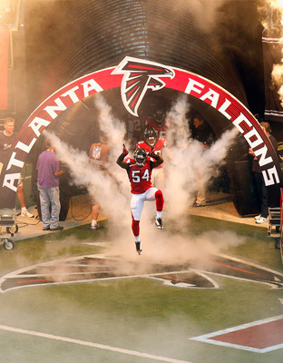 ATLANTA - NOVEMBER 07:  Stephen Nicholas #54 of the Atlanta Falcons enters the field during defensive player introductions before facing the Tampa Bay Buccaneers at Georgia Dome on November 7, 2010 in Atlanta, Georgia.  (Photo by Kevin C. Cox/Getty Images