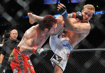 PORTLAND, OR - AUGUST 29:  UFC fighter Chris Leben (L) battles UFC fighter Jake Rosholt (R) during their Middleweight bout at UFC 102:  Couture vs. Nogueira at the Rose Garden Arena on August 29, 2009 in Portland, Oregon.  (Photo by Jon Kopaloff/Getty Ima