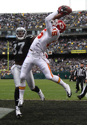 OAKLAND, CA - NOVEMBER 07:  Verran Tucker #15 of the Kansas City Chiefs catches a touchdown pass over Chirs Johnson #37 of the Oakland Raiders during an NFL game at Oakland-Alameda County Coliseum on November 7, 2010 in Oakland, California.  (Photo by Jed