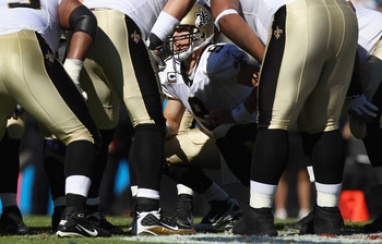 CHARLOTTE, NC - NOVEMBER 07:  Drew Brees #9 of the New Orleans Saints calls a play against the Carolina Panthers during their game at Bank of America Stadium on November 7, 2010 in Charlotte, North Carolina.  (Photo by Streeter Lecka/Getty Images)